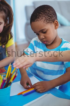 Happy kid enjoying arts and crafts painting Stock photo © wavebreak_media