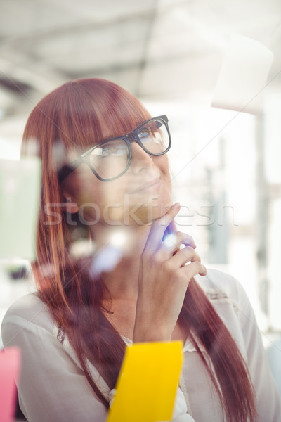 Attractive hipster woman looking at sticky notes Stock photo © wavebreak_media