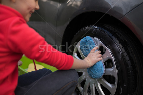 Teenage girl washing a car on a sunny day Stock photo © wavebreak_media
