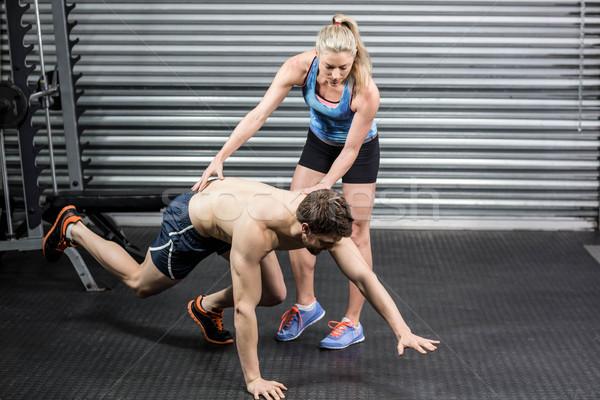 Woman trainer assisting man  Stock photo © wavebreak_media