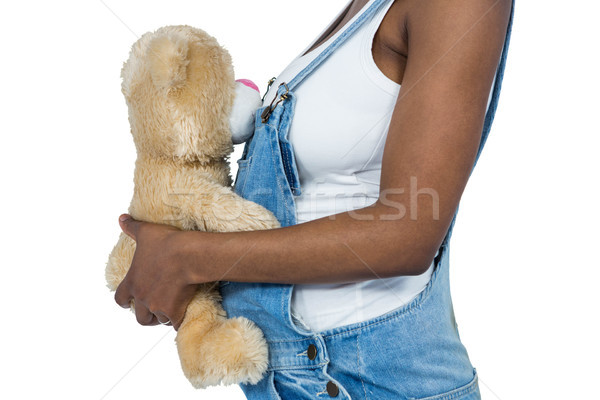 Pregnant woman holding a teddy bear Stock photo © wavebreak_media