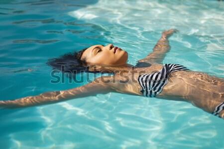 Güzel bir kadın su yüzme havuzu spa Stok fotoğraf © wavebreak_media