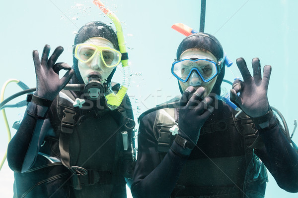 Couple practicing scuba diving together Stock photo © wavebreak_media