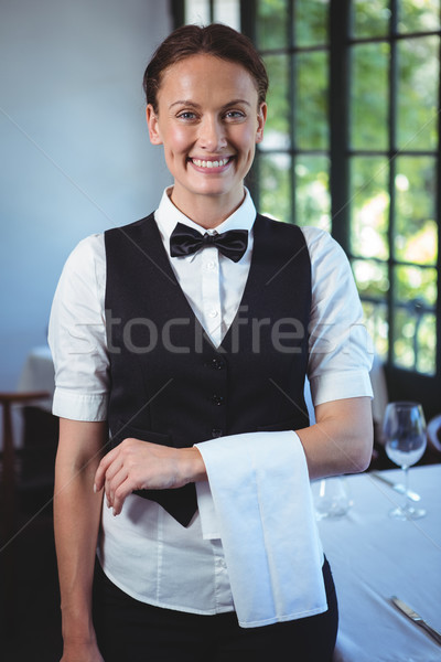 Waitress posing with crossed arms Stock photo © wavebreak_media