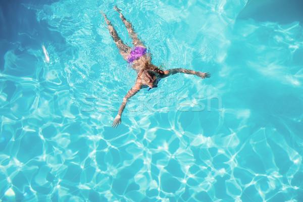 Mujer natación piscina casa sol Foto stock © wavebreak_media