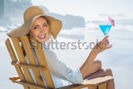 Blonde woman drinking cocktail Stock photo © wavebreak_media