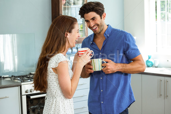 Young couple enjoying while having cup of coffee Stock photo © wavebreak_media