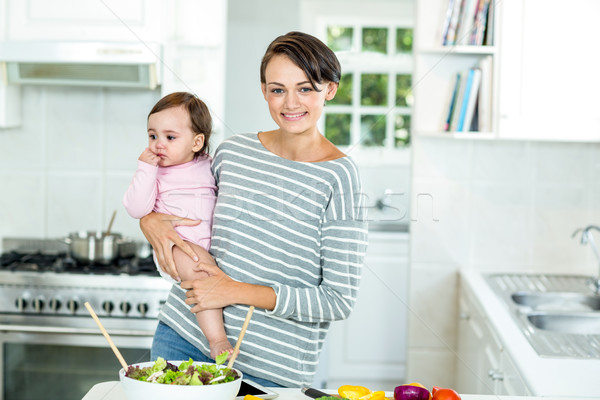 Happy mother with baby boy by kitchen counter Stock photo © wavebreak_media