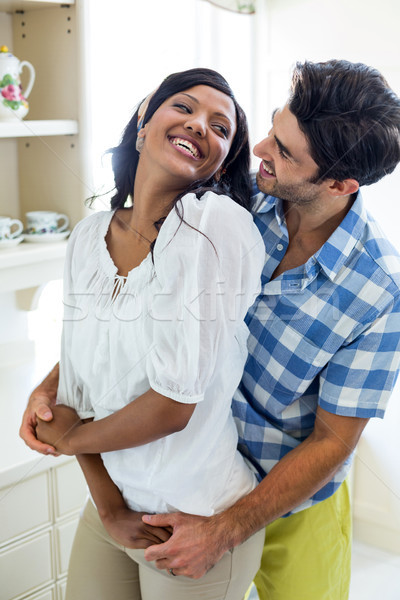 Happy young couple embracing each other Stock photo © wavebreak_media
