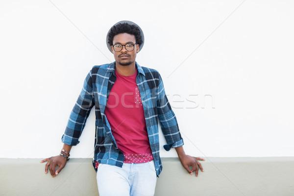 Young man standing on terrace Stock photo © wavebreak_media