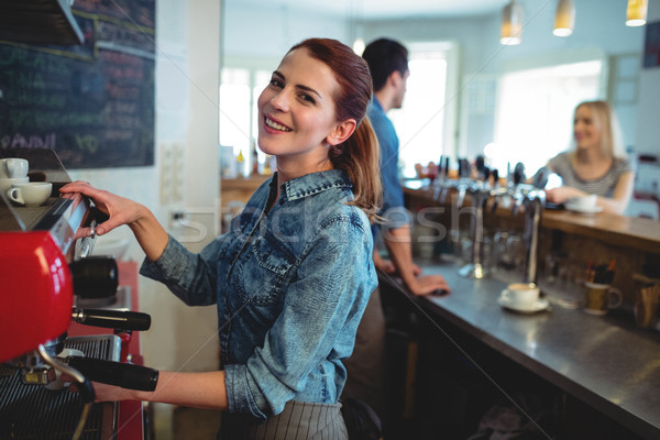 Portrait of happy waitress with co-worker talking to customer at Stock photo © wavebreak_media