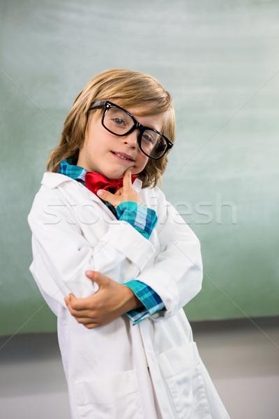 Boy dressed as scientist standing in classroom Stock photo © wavebreak_media