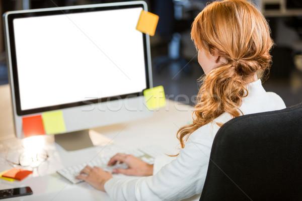 Businesswoman working on computer Stock photo © wavebreak_media