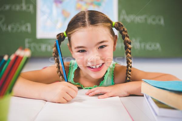 Portrait souriant écolière devoirs classe école Photo stock © wavebreak_media
