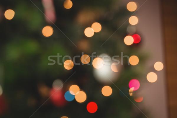 Defocused of christmas tree lights and fireplace Stock photo © wavebreak_media