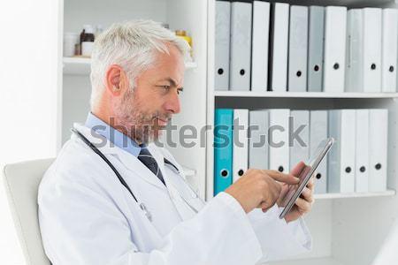 Médecin xray rapport clinique homme heureux Photo stock © wavebreak_media