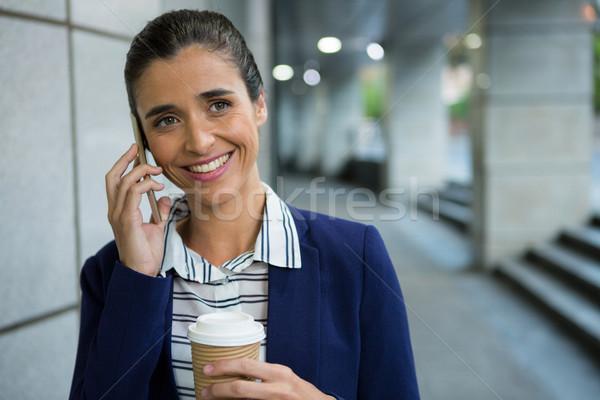 Business uitvoerende praten mobiele telefoon koffie glimlachend Stockfoto © wavebreak_media