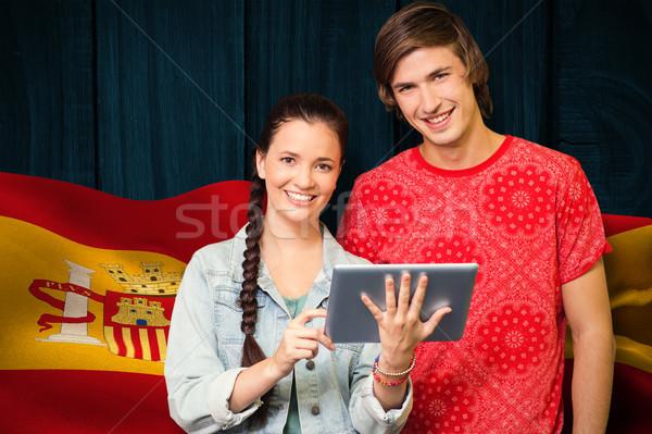 Composite image of smiling classmates with tablet pc Stock photo © wavebreak_media