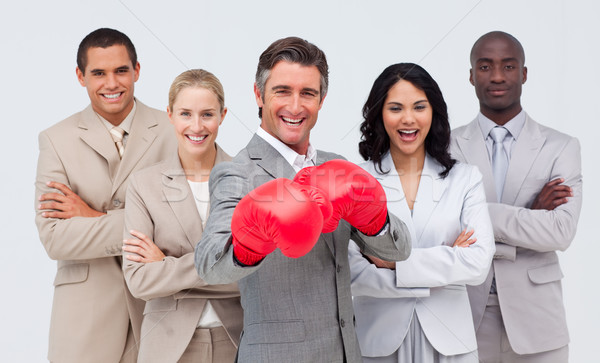 Smiling businessman with boxing gloves leading his team Stock photo © wavebreak_media