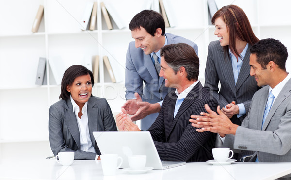 Laughing businesswoman applauded by her team Stock photo © wavebreak_media