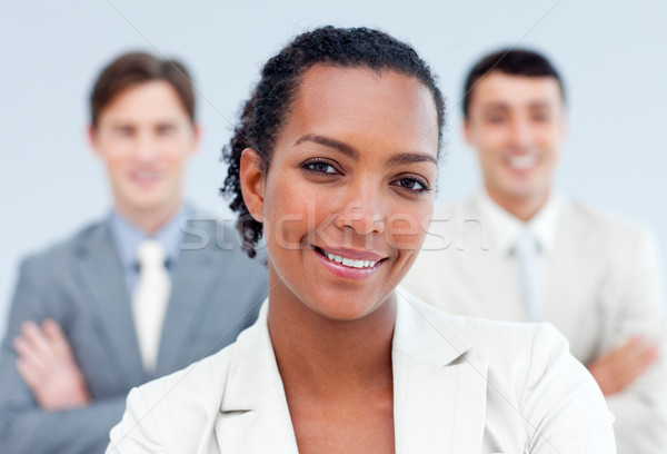 Stock photo: Positive business partners standing with folded arms