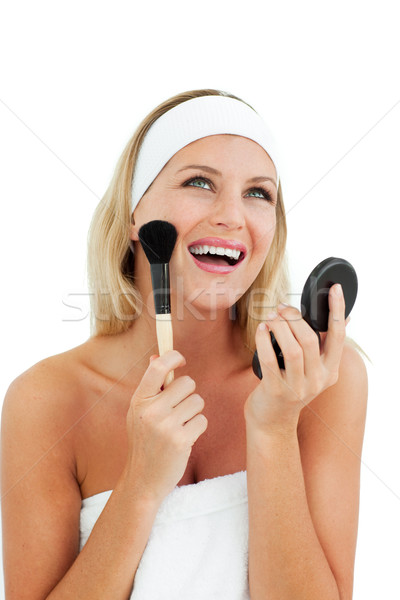 Sparkling woman putting on make-up  Stock photo © wavebreak_media