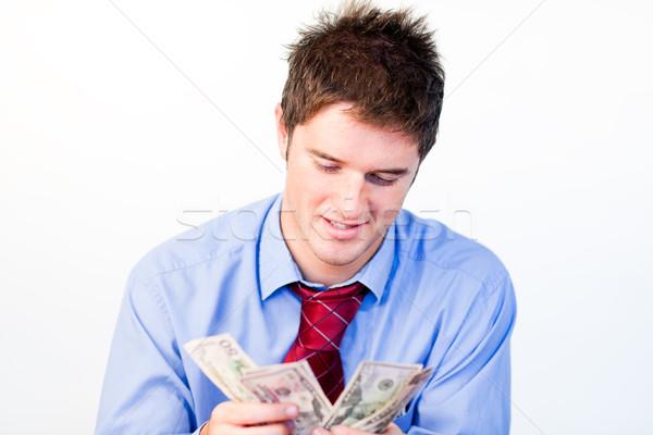 Portrait of man counting money Stock photo © wavebreak_media