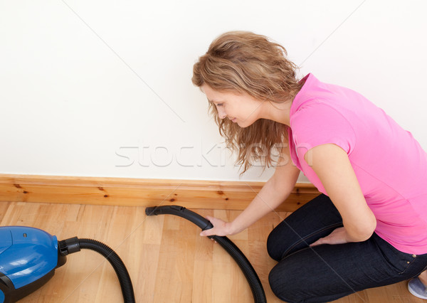 Stock photo: Portrait of a charming woman vacuuming