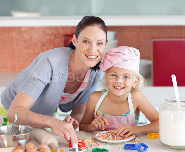 Laughing mother and her daughter baking in a kitchen Stock photo © wavebreak_media