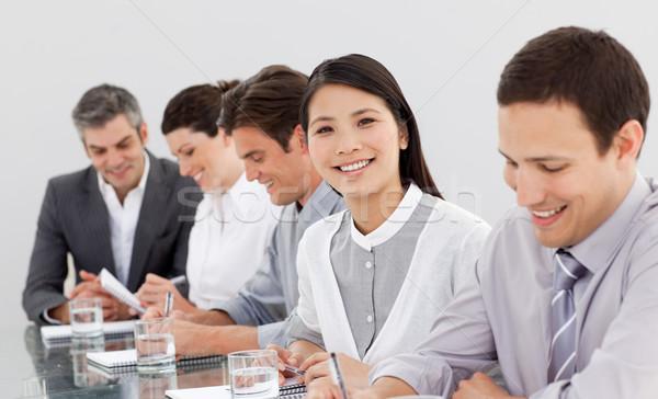 Souriant prendre des notes réunion bureau heureux Photo stock © wavebreak_media