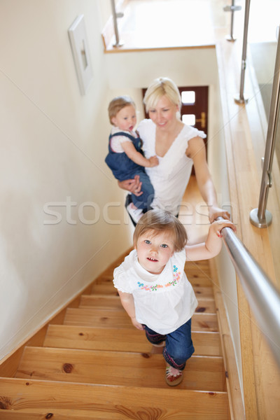 Family is on the staircase Stock photo © wavebreak_media