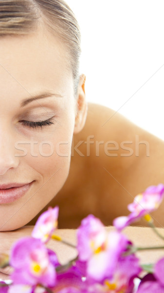 Portrait of a blond young woman lying on a massage table in a spa center Stock photo © wavebreak_media