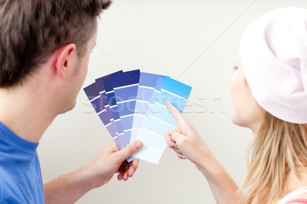 Concentrated young couple choosing color for a room in their new house Stock photo © wavebreak_media