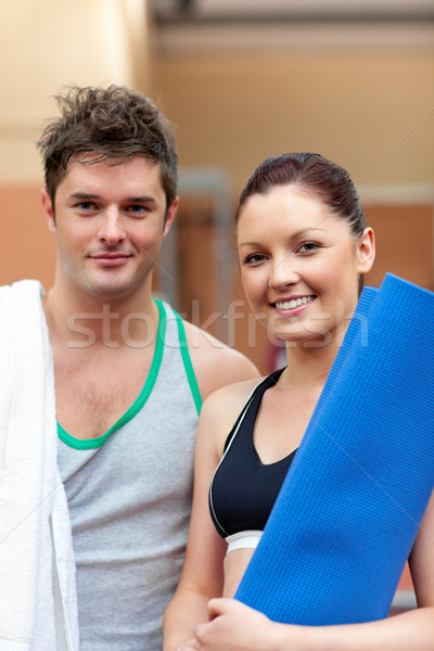 portrait of a happy couple after fitness exercices smiling to the camera in a fitness centre  Stock photo © wavebreak_media