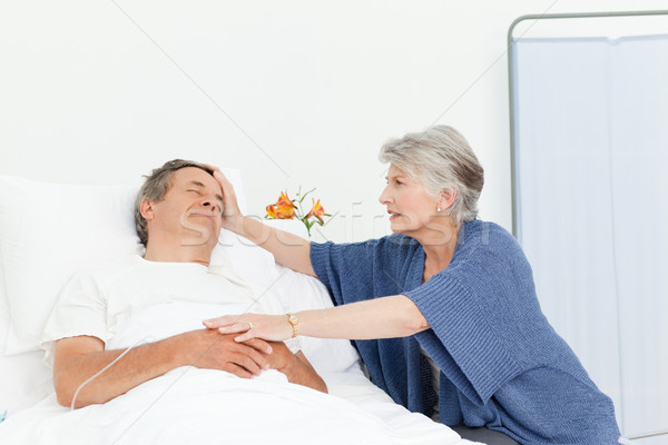 Mature woman taking care of her husband  Stock photo © wavebreak_media
