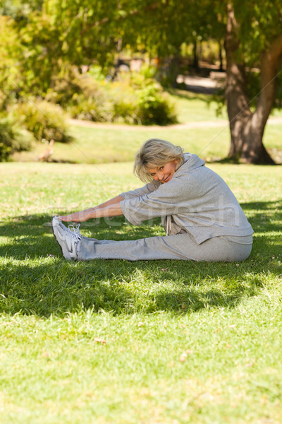Mature woman doing her streches in the park Stock photo © wavebreak_media