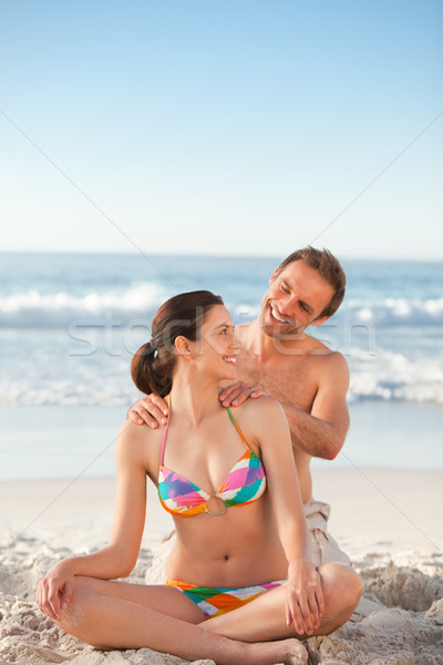 Attentive man applying sun cream on his girlfriend's back Stock photo © wavebreak_media