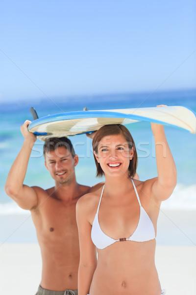 Lovers with their surfboard Stock photo © wavebreak_media