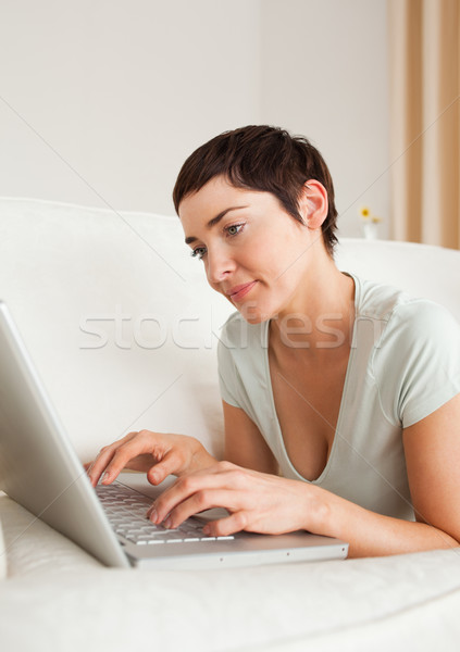 Portrait of a gorgeous short-haired woman using a laptop in her living room Stock photo © wavebreak_media