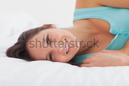 Photograph of a gorgeous red-haired woman in her bedroom Stock photo © wavebreak_media