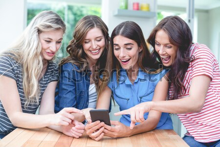 Cute women lying on the floor taking a picture in a living room Stock photo © wavebreak_media