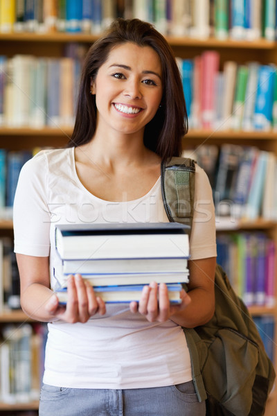 Portrait of a student holding books in the library Stock photo © wavebreak_media