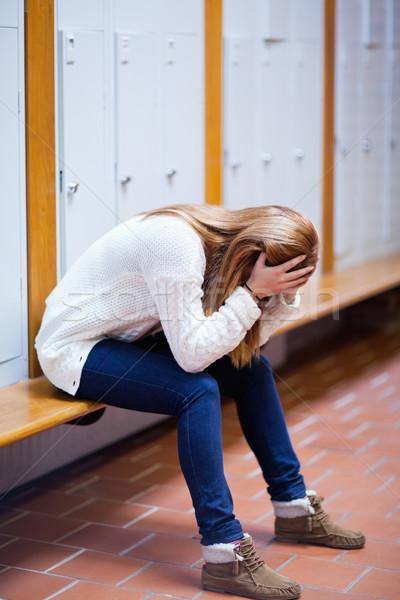 Retrato deprimido estudiante sesión banco corredor Foto stock © wavebreak_media