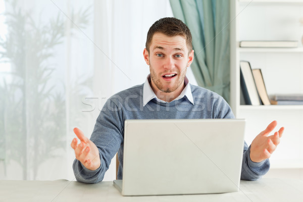 Young businessman clueless about his notebook in his homeoffice Stock photo © wavebreak_media
