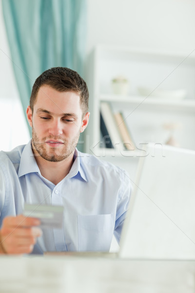 Young businessman with laptop and credit card in his homeoffice Stock photo © wavebreak_media