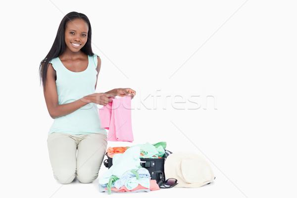 Mosolyog fiatal nő csomagol fehér szépség utazás Stock fotó © wavebreak_media