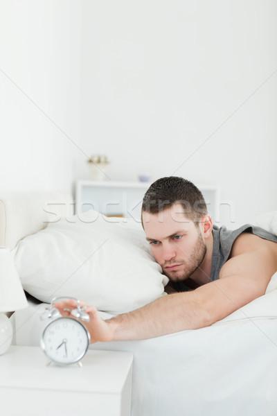 Portre mutsuz adam çalar saat yatak odası iş Stok fotoğraf © wavebreak_media