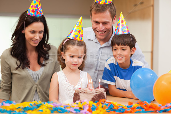 Young girl about to blow out the candles on her birthday cake Stock photo © wavebreak_media