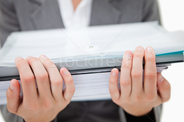 Pile of paperwork being held by female hands against a white background Stock photo © wavebreak_media