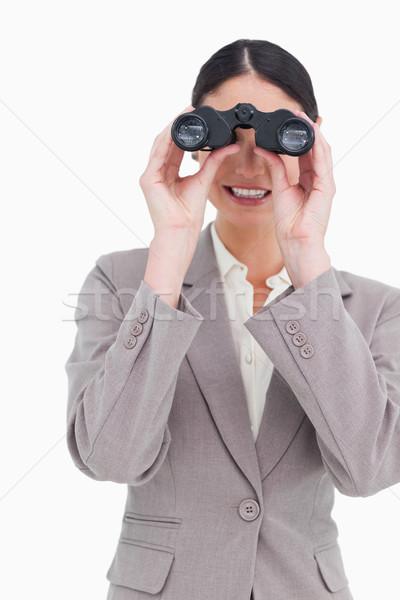 Businesswoman looking through binoculars against a white background Stock photo © wavebreak_media